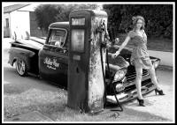 old petrol pump with low truck